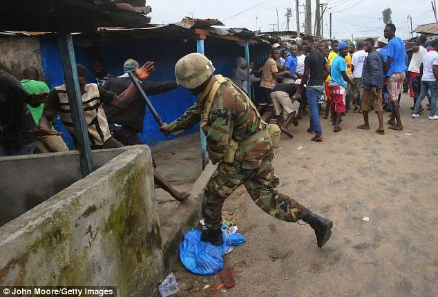 [SHOCKING] Liberian Soldiers Shoot At Residents Of Ebola Slum {See Photos}