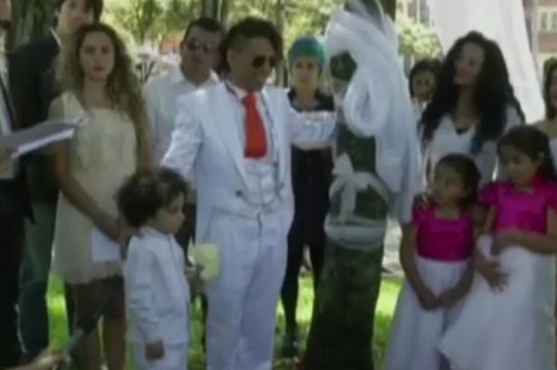 Strange: Man Marries A Tree For The Second Time {See Photos}