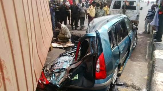 Photos: Container falls on a car carrying a family of five in Lagos