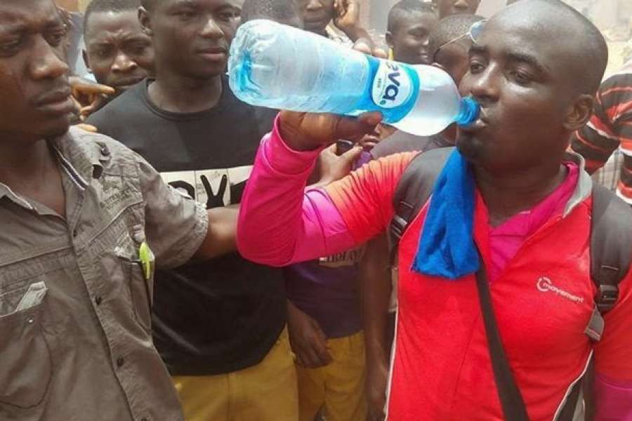 PHOTOS: Man Trekking From Lagos To Abuja Over Buhari's Election Victory Finally Arrives