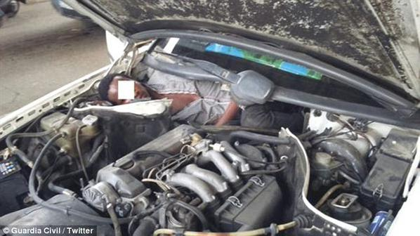 [PHOTO] African Migrant Caught Hiding In Car's Engine In Attempt To Enter Spain