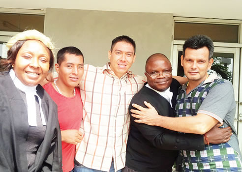 [PHOTO] Three Bolivians Celebrate As Court In Lagos Sentences Them To Six Years In Prison For Drug Offences