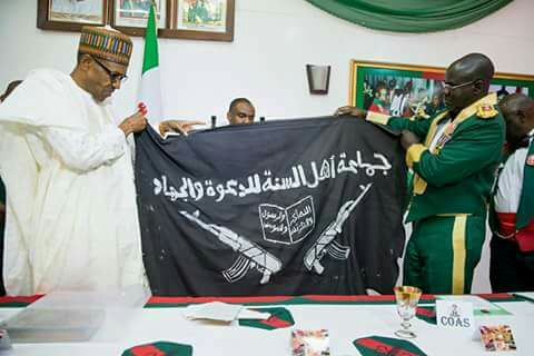 Image result for shekau and his flag and quran