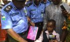 7 year old boy presents card to police